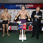 Istanbulls Onur SIPAL (L) and Kremlin Bears Sukhrab SHIDAEV (C) boxers seen during their Presentation and the weighing ceremony matchday 5 of the World Series of Boxing at Ahmet Comert Arena in Istanbul, Turkey, Thursday, January 27, 2011. Photo by TURKPIX