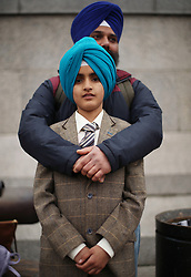 Surjit Singh with his son Ajit Singh, aged 10, during the Mayor of London Vaisakhi celebrations in Trafalgar Square, London, to mark the Sikh New Year.