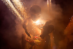 © Licensed to London News Pictures. 05/11/2015. Lewes, UK. A David Cameron effigy is being burnt on a bonfire in Lewes, Sussex during the traditional Bonfire Night celebrations on Thursday, 5 November, 2015. Thousands of people attend the parade through the narrow streets of Lewes and burn effigies to celebrate Guy Fawke night. Photo credit: Tolga Akmen/LNP