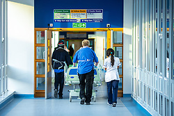 © Licensed to London News Pictures . 11/02/2021. Wythenshawe , UK . A porter pushes a patient on a trolley along a corridor in Wythenshawe Hospital . Photo credit : Joel Goodman/LNP