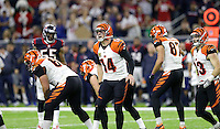 Cincinnati Bengals' Andy Dalton (14) calls a play against the Houston Texans during the second half of an NFL football game Saturday, Dec. 24, 2016, in Houston. (AP Photo/Sam Craft)
