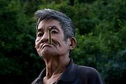 A man smokes a cigarrete made from bamboo, in Thailand. PHOTO TIAGO MIRANDA