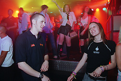 Young man and woman dancing together in nightclub,