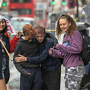 UK Weather:  Pedestrians Socked in with Rain at Whitehall in Rainy London, UK. 19 July 2019.