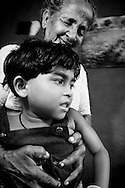 W.G Dayawathi och barnbarnet Sanduni Sankalpini i byn Siriyagama, Sri Lanka.NOT FOR COMMERCIAL USE UNLESS PRIOR AGREED WITH PHOTOGRAPHER. (Contact Christina Sjogren at email address : cs@christinasjogren.com )