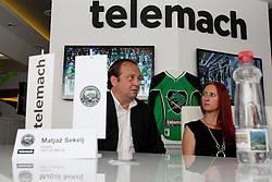 Matjaz Sekelj and Ditka Maucec of UPC Telemach at HDD UPC Telemach Olimpija Press Conference about new main sponsor UPC Telemach as main sponsor of HDD Olimpija, on June 20, 2012 at UPC Telemach, Ljubljana, Slovenia. (Photo By Matic Klansek Velej / Sportida)