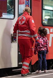 13.09.2015, Hauptbahnhof Salzburg, AUT, Fluechtlinge am Hauptbahnhof Salzburg auf ihrer Reise nach Deutschland, im Bild eine Mitarbeiterin des Roten Kreuz ist einem Flüchtlingskind behilflich // an employee of the Red Cross is helping a refugee child. According to reports thousands of refugees fleeing violence and persecution in their own countries continue to make their way toward the EU, just days before Euopean leaders are set to meet in Brussels to discuss a solution to the arrival of so many people, Main Train Station, Salzburg, Austria on 2015/09/13. EXPA Pictures © 2015, PhotoCredit: EXPA/ JFK