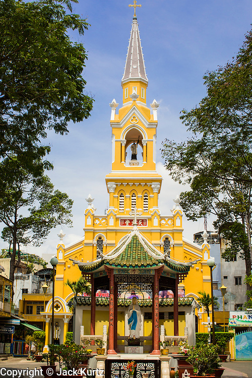 """12 APRIL 2012 - HO CHI MINH CITY, VIETNAM:  Cha Tam Catholic Church in Cholon. The church is best known as the last hiding placing of Vietnamese Catholic dictator and US ally, President Ngo Dinh Diem, before he was assassinated in November 1963. Cholon is the Chinese-influenced section of Ho Chi Minh City (former Saigon). It is the largest """"Chinatown"""" in Vietnam. Cholon consists of the western half of District 5 as well as several adjoining neighborhoods in District 6. The Vietnamese name Cholon literally means """"big"""" (lon) """"market"""" (cho). Incorporated in 1879 as a city 11km from central Saigon. By the 1930s, it had expanded to the city limit of Saigon. On April 27, 1931, French colonial authorities merged the two cities to form Saigon-Cholon. In 1956, """"Cholon"""" was dropped from the name and the city became known as Saigon. During the Vietnam War (called the American War by the Vietnamese), soldiers and deserters from the United States Army maintained a thriving black market in Cholon, trading in various American and especially U.S Army-issue items.         PHOTO BY JACK KURTZ"""