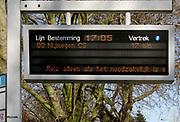 Nederland, Leuth, 4-4-2020  Op het elektronische bord van de dienstregeling van de regionale busdienst wordt de reizigers geadviseerd zo min mogelijk te reizen om de verspreiding va het coronavirus zoveel mogelijk tegen te gaan . Foto: Flip Franssen