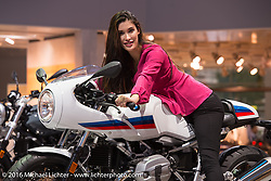 A model aboard the just released BMW Cafe Racer (on the RNine-T platform) in the BMW Motorcycles display at the Intermot Motorcycle Trade Fair. Cologne, Germany. Thursday October 6, 2016. Photography ©2016 Michael Lichter.