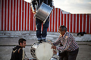 "Father Abdush (right) and his sons Mersid (left), Erdal ( behind) and Ergul (on top) during a drum session on a stage in front of the ""House of Culture"" in Delcevo, Macedonia. The Roma family - father and his 3 sons - are well know for their drum perfomances and also they build their drums themselves."