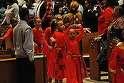 """Dancer Kirsten Richardson,6 leads a group of Chicago Catholic School liturgical dancers during the opening of the 33rd Annual African American Heritage Month Eucharistic Celebration at Holy Name Cathedral. This year's mass celebrates the the Nguzo Saba principle of Kuumba, or """"creativity"""" at Holy Name Cathedral."""