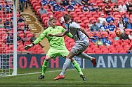 Karl Dryden (Morpeth Town) spreads himself as John Mills (Hereford FC) is in on goal. However, the ball drops behind him and Dryden collects the ball and clears during the FA Vase match between Hereford and Morpeth Town at Wembley Stadium, London, England on 22 May 2016. Photo by Mark Doherty.