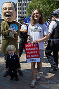 On the day that the Conservative Party elects its leader and the countrys Prime Minister, Boris Johnson, a Boris puppet and Nigel Farage puppetmaster appears outside the QE2 Centre to learn the result, on 23rd July 2019, in Westminster, London, England.