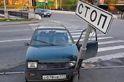 Moscow, Russia 13/05/2007..A car driven by a drunken driver crashed into a stop sign at at a road junction. The man was uninjured but was so drunk he could not walk without assistance.
