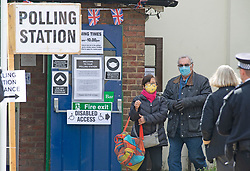 © Licensed to London News Pictures 06/05/2021. Bromley, UK. People coming and going at Hayes Village Hall in Bromley, London. Local council Elections 2021. Polling stations have opened across the UK today to allow people to vote for their Local councillors, police and crime commissioners and Londoners will get to elect the next Mayor of London. Due to Coronavirus people have to wear masks when voting. Photo credit:Grant Falvey/LNP