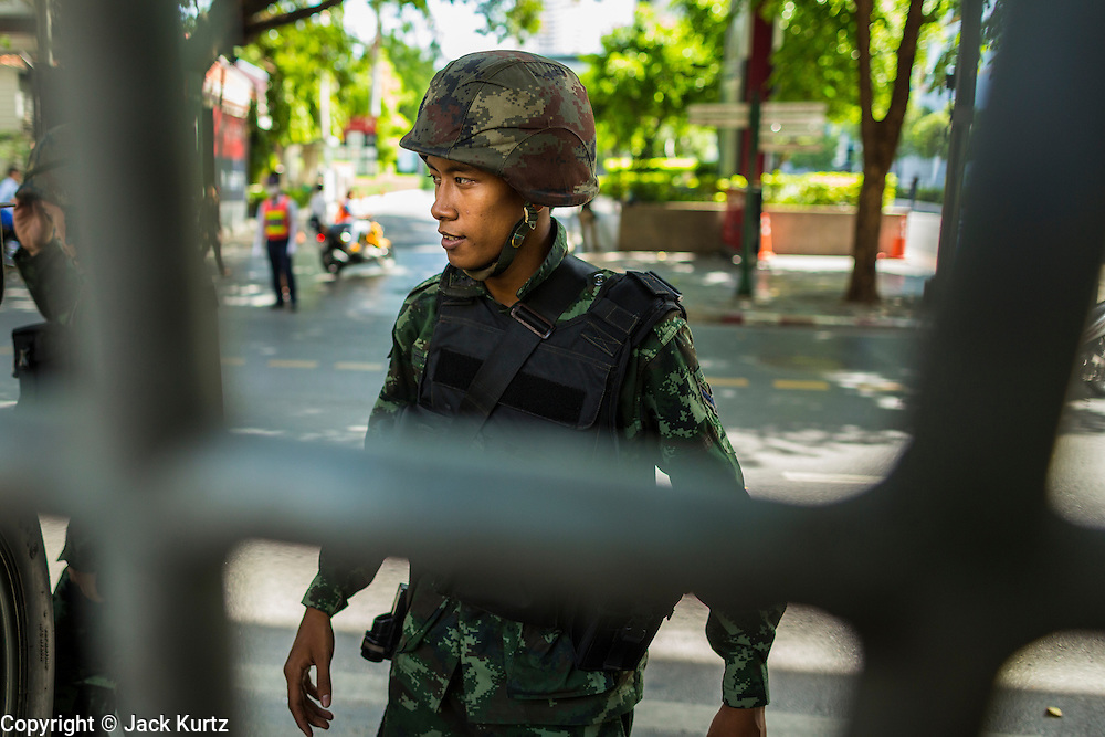 """20 MAY 2104 - BANGKOK, THAILAND:  A Thai soldier at a checkpoint on Rama I Road in Bangkok. The Thai Army declared martial law throughout Thailand in response to growing political tensions between anti-government protests led by Suthep Thaugsuban and pro-government protests led by the """"Red Shirts"""" who support ousted Prime Minister Yingluck Shinawatra. Despite the declaration of martial law, daily life went on in Bangkok in a normal fashion. There were small isolated protests against martial law, which some Thais called a coup, but there was no violence.  PHOTO BY JACK KURTZ"""