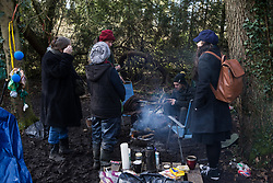 Denham, UK. 11 February, 2020. Amelia Womack (r), Deputy Leader of the Green Party, meets environmental activists from Extinction Rebellion, Stop HS2 and Save the Colne Valley at a protest camp at Denham in the Colne Valley. Contractors working on behalf of HS2 are rerouting electricity pylons through a nearby Site of Metropolitan Importance for Nature Conservation (SMI) in conjunction with the high-speed rail link.
