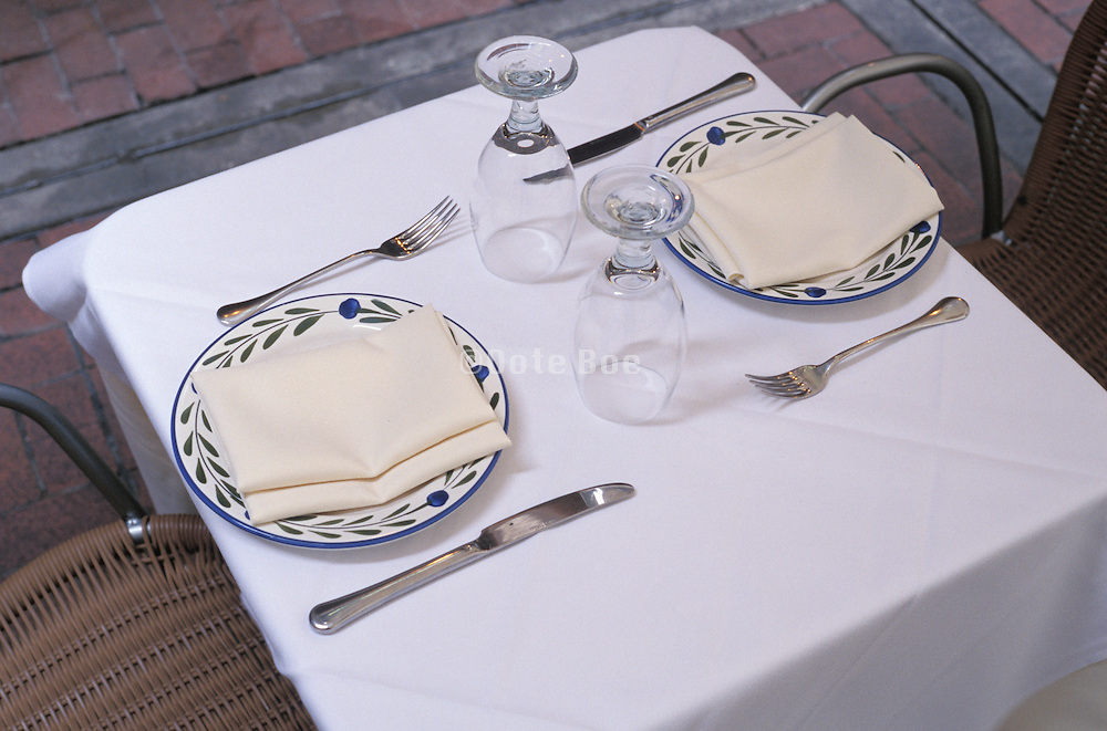 table setting with two plates and utensils.