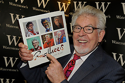 """© Licensed to London News Pictures. 19/04/2013.Rolf Harris has been named as the veteran entertainer who was arrested by police investigating allegations of sexual abuse following the Jimmy Savile scandal..Harris, 83, a former resident of Sydenham, was originally interviewed by detectives from Scotland Yard's Operation Yewtree in November 2012 and was then arrested over the allegations on March 28 2013..(File Image 27.11.2010). Rolf Harris at Waterstones book store at the Bluewater Shopping complex in Kent.  . launching his new book. Rolf Harris """"A Life in Art"""".. Photo credit : Grant Falvey/LNP"""