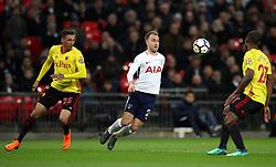 Tottenham Hotspur's Christian Eriksen (centre) controls the ball during the Premier League match at Wembley Stadium. London.