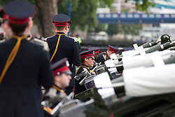 © licensed to London News Pictures. LONDON, UK  02/06/11. Members of the Honourable Artillery Company (HAC) prepare to fire a 62 gun salute at the Tower of London to mark the anniversary of the Queen's ascension to the throne in 1953 . Please see special instructions for usage rates. Photo credit should read Matt Cetti-Roberts/LNP