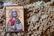 A printed image of Jesus on the stone walls of a church in Enfe, Lebanon. (September 6, 2010)
