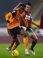 Football - 2020 / 2021 Premier League - Burnley vs Wolverhampton Wanderers - Turf Moor<br /> <br /> Owen Otasowie of Wolves and Ashley Westwood of Burnley at Turf Moor <br /> <br /> <br /> COLORSPORT/LYNNE CAMERON