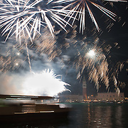 VENICE, ITALY - DECEMBER 31:  A vaporetto sails during the fireworks display in St. Mark's Square during New Year's Eve street party on December 31, 2011 in Venice, Italy.  Official figures say that around seventy thousand people gathered in St. Mark Square for this year's street celebrations.