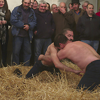 Galhofa is a form of wrestling from Trás-Os-Montes region, performed by men in bare trunks over hay accompanied by a band of bagpipe and drums, very commom of the winter solstice traditions.