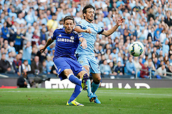 Nemanja Matic of Chelsea clears from David Silva of Manchester City - Photo mandatory by-line: Rogan Thomson/JMP - 07966 386802 - 21/08/2014 - SPORT - FOOTBALL - Manchester, England - Etihad Stadium - Manchester City v Chelsea FC - Barclays Premier League.