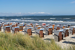 View of traditional Strandkorb chairs on beach at Binz seaside resort on Rugen Island in Germany