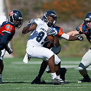 Fullerton Hornet wide receiver Daurice Simpson (89) is surrounded Orange Coast Pirate linebacker Brandon Safford (47)  and defensive back K.J. Walker (41) and eventually forced out of bounds. Cal State Fullerton  Football vs. Orange Coast College College on Saturday, November 5, 2016 at LeBard Stadium in Costa Mesa, CA.  © photo by Annette Wilkerson/Sports Shooter Academy
