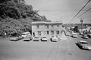falconer 383F-06.  Newport, Oregon. Harbor Barber 460 SW Bay Blvd. Jack's Seafoods 456 SW Bay Blvd. September 1971