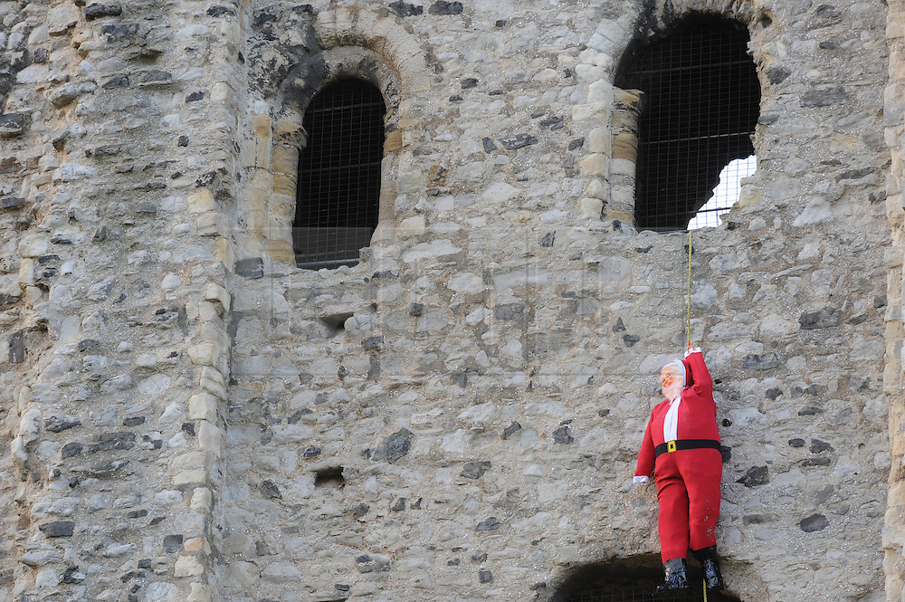© Licensed to London News Pictures. 14/11/2013<br /> Suicidal Santa,Rochester,Kent.<br /> Kent Police were called to Rochester Castle on the 12th November at 6.26pm after members of the public were concerned about a mans welfare.  After Kent Police arrived they soon realised the man in need of help was not a man at all, It was a Santa Claus mannequin which has been hung by a rope from the castle to promote the up coming Medway Santa Fun Run.<br /> Photo credit :LNP