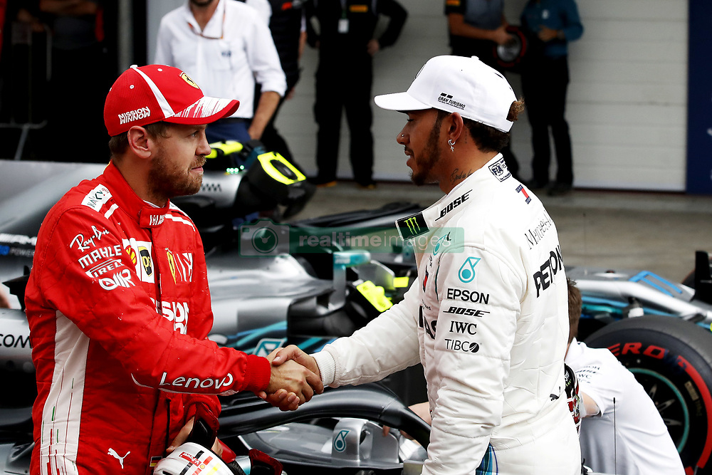 November 10, 2018 - Sao Paulo, Sao Paulo, Brazil - Nov, 2018 - Mercedes LEWIS HAMILTON(r) driver who has won the pole position greets the Ferrari SEBASTIAN VETTEL of Ferrari, who finished second in the starting grid after qualifying training of Formula One Grand Prix Brazil at the José Carlos Pace racetrack (Interlagos) in the city of Sao Paulo. Sao Paulo, Brazil, November 10, 2018. (Credit Image: © Marcelo Chello/ZUMA Wire)