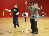 Middletown, New York - Boys play with hula hoops at Family Night at the Middletown YMCA on April 2, 2011.