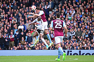 Fulham striker Sone Aluko (24) is out jumped by Aston Villa defender Tommy Elphick (6) during the EFL Sky Bet Championship match between Fulham and Aston Villa at Craven Cottage, London, England on 17 April 2017. Photo by Jon Bromley.