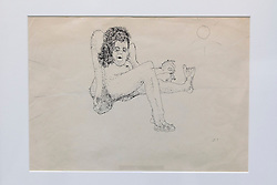 "© Licensed to London News Pictures. 21/03/2014. London, UK. 'Untitled illustration of a hairy woman holding a miniature man by the arm' (GB£12,000-15,000) by the late Beetles singer John Lennon, allegedly the piece that brought him to the attention of his future wife Yoko Ono, is seen during the press view for a new sale at Sotheby's auction house in London today (21/03/2014). The auction, entitled ""You Might Well Arsk"", features original drawings and manuscripts by the singer from 1964-1965. Photo credit: Matt Cetti-Roberts/LNP"
