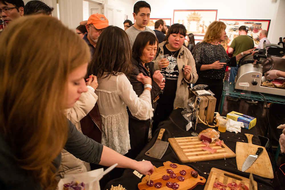 Flushng, NY - February 25, 2017. Visitors sampling cured meats at Ends Meat, a whole-animal salumeria in Brooklyn, NY, at the 2017 Charcuterie Masters at Flushing Town Hall.