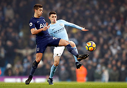 Tottenham Hotspur's Harry Winks (left) and Manchester City's Phil Foden battle for the ball during the Premier League match at the Etihad Stadium, Manchester.