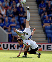 Photo: Henry Browne.<br /> Leicester City v Luton. Coca Cola Championship.<br /> 27/08/2005.<br /> Ahmer Brkovic of Luton is squashed by Nils-Eric Johansson of City.