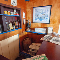 A risque magazine graces the counter of a small bar in a hut at Port Lockroy, an abandoned British Science base on Goudier Island, Antarctica that has been restored as a museum.