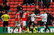 tempers flair as Cyrus Christie of Derby County & Morgan Fox of Charlton Athletic square up to each other while Charlton's Jorge Teixeira © steps in to calm things down.. Skybet football league championship match, Charlton Athletic v Derby County at The Valley  in London on Saturday 16th April 2016.<br /> pic by Steffan Bowen, Andrew Orchard sports photography.