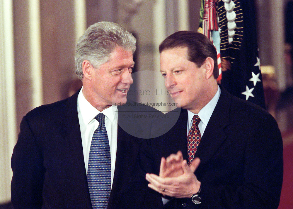President Bill Clinton talks with Vice President Al Gore (R) before unveiling the Year 2000 federal budget February 1, 1999 at a White House ceremony in Washington, DC.