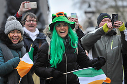 © Licensed to London News Pictures. 18/03/2018. LONDON, UK. Spectators in fancy dress. The 16th annual London St. Patrick's Day parade takes place through central London.  Tens of thousands of people enjoy the parade as well as festivities in Trafalgar Square.  The event showcases the best of Irish food, music, song, dance, culture and arts and this year, celebrates the achievements and successes of London's Irish women as part of the Mayor of London's #BehindEveryGreatCity campaign.   Photo credit: Stephen Chung/LNP
