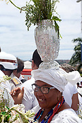Bahiana in tradtional dress carrying a vase on her head, Every second 2nd Thursday in February thousands of people attend the Lavagem do Bonfim - The washing of Bonfim at the Iglesia do Bonfim - Church of Bonfim in Salvador de Bahia,