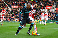 Fernandinho of Manchester City shields the ball from Ibrahim Afellay of Stoke City. Barclays Premier league match, Stoke city v Manchester city at the Britannia Stadium in Stoke on Trent, Staffs on Saturday 5th December 2015.<br /> pic by Chris Stading, Andrew Orchard sports photography.