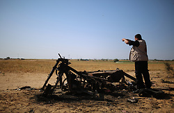 April 14, 2018 - Rafah, Palestinian Territories, Palestine - Palestinian men look at the debris of a motorcycle at the site of an explosion in east of Rafah in the southern Gaza Strip, on April 14, 2018. Four Palestinians were killed in an explosion near the Gaza-Israel border, the health ministry in Gaza said, in circumstances that were unclear. The Hamas-controlled ministry said the explosion east of Rafah was caused by an Israeli strike, but an army spokesman said they no knowledge of any such strike. (Credit Image: © Majdi Fathi/NurPhoto via ZUMA Press)