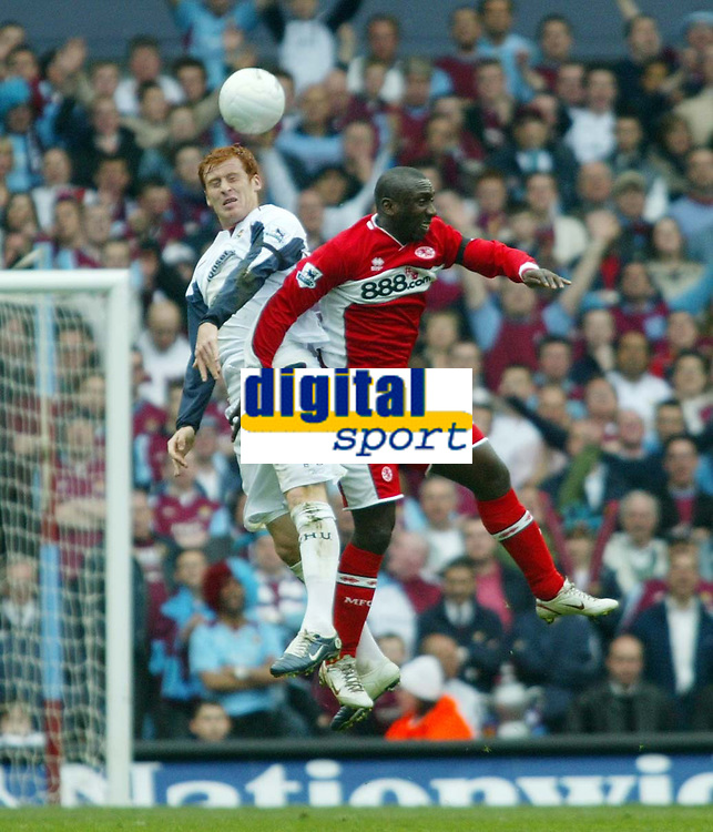 Photo: Chris Ratcliffe.<br /> Middlesbrough v West Ham United. The FA Cup, Semi-Final. 23/04/2006.<br /> James Collins of West Ham clashes with Jimmy Floyd Hasselbaink of Middlesbrough